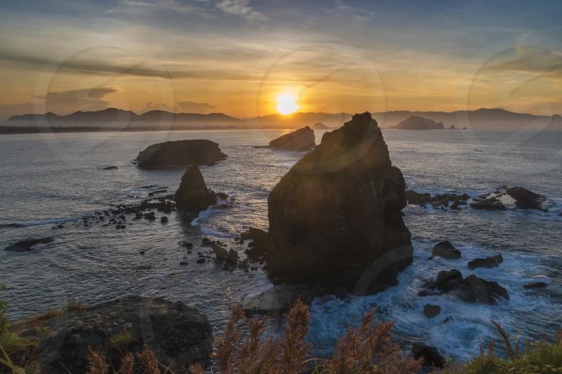 Morning at Tanjung Papuma Beach East Java Indonesia photo