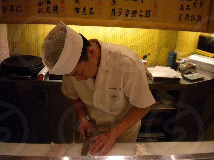 chef slicing a fillet photo