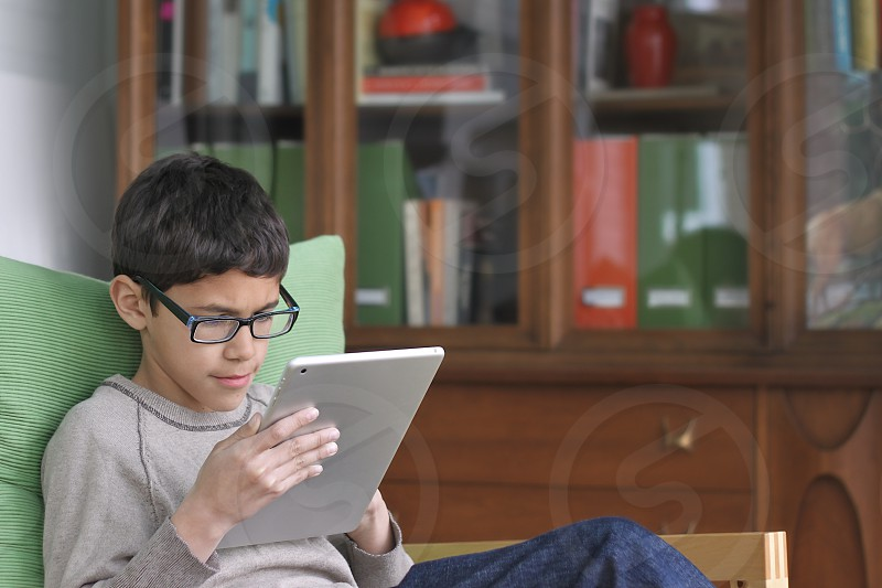 boy using tablet / iPad photo
