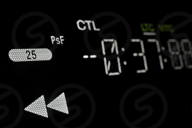 """""""Perspective macro shot of the display of the professional hdcam video player.  Shallow dof. Visible data: fast backward arrows timecode 25 psf CTL LTC VITC"""" photo"""