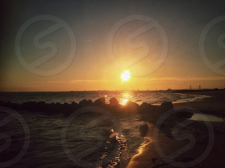 sunrise view from the sea water photo