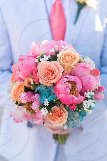Bouquet hold wedding flowers peonies pink blue groom bridal colorful photo