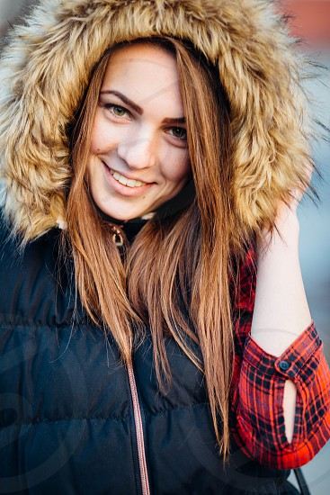 Portrait of young pretty girl smiling to the Camera. Happy eyes face hair autumn photo