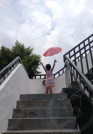 Umbrella childSkytree girlrainbow happy freedomsuccess clouds  photo