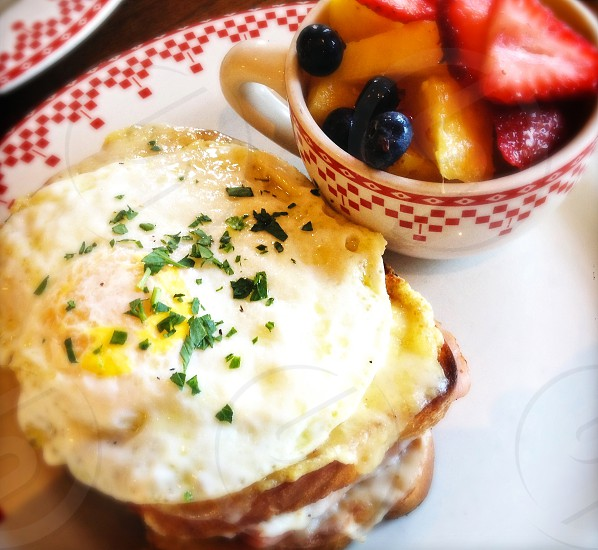 Croque Madame fried egg on ham sandwich with Gruyere cheese and bechamel sauce photo