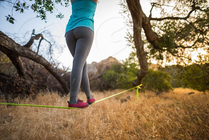 person doing tightrope on the ground photo