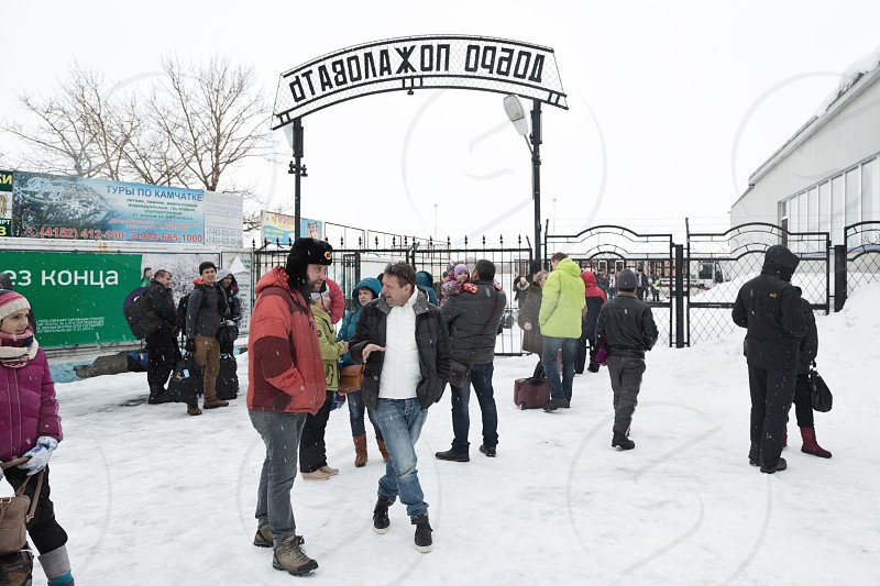 PETROPAVLOVSK-KAMCHATSKY KAMCHATKA RUSSIA - MARCH 19 2015: People in zone exit of passengers from platform. Terminal airport Petropavlovsk-Kamchatsky City (Yelizovo airport) on Far East Russia. photo