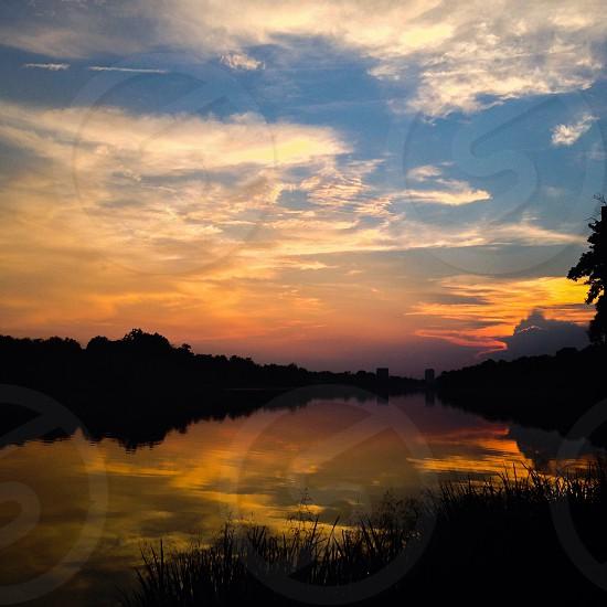 Sunset Augusta Georgia Savannah River evening reflection clouds photo