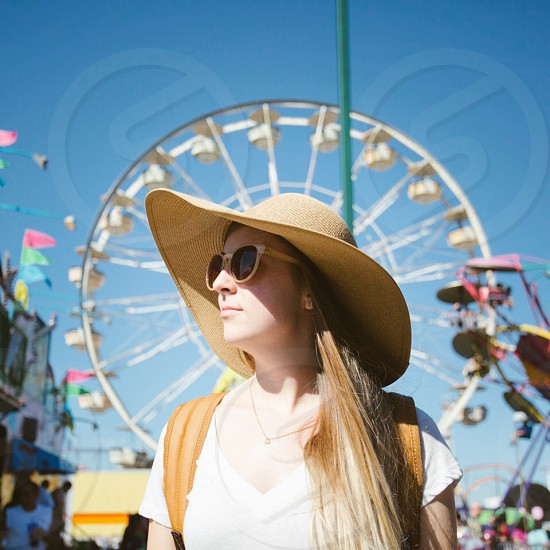 woman in white blouse and  beige sun hat photo