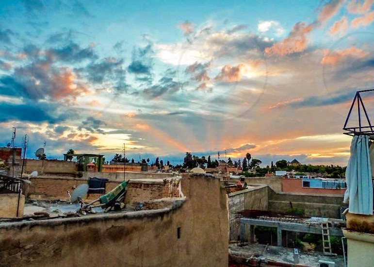 Outdoor day horizontal colour morocco Marrakech Africa sunset bright Rays sunshine rooftop photo