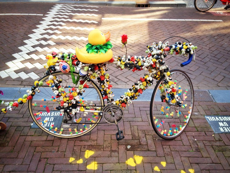 multi colored decor on bike photo