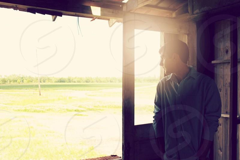 man in blue dress shirt near door photo