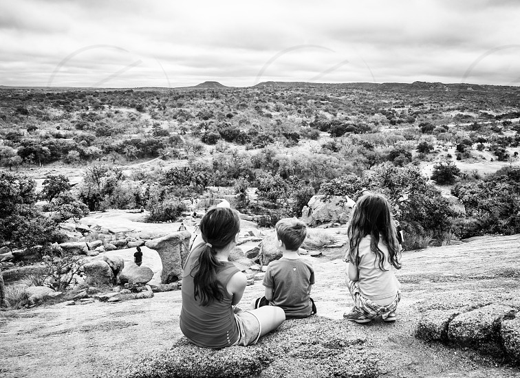 Kids looking out over desert landscape photo