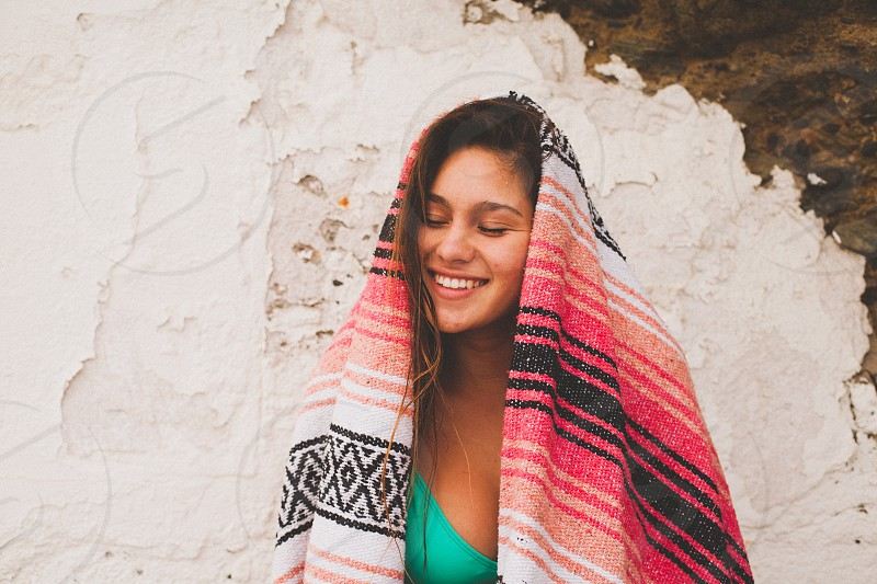 woman covered by blanket smiling photo