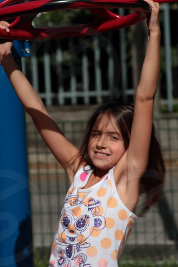 Young girl playing in playground photo