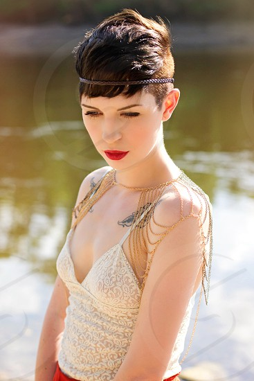 river water ocean lake pixie cut pixie short hair model white pale tattoos ethereal red lips photo