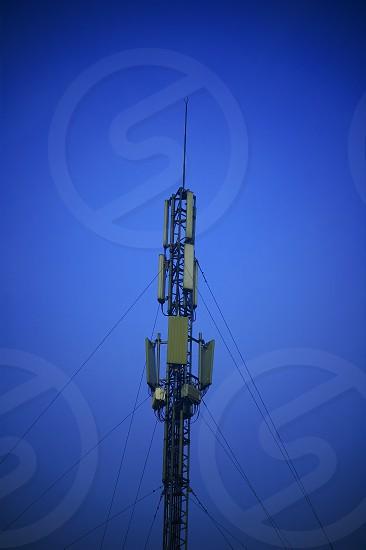 modern telecomunications antenna over a blue sky photo