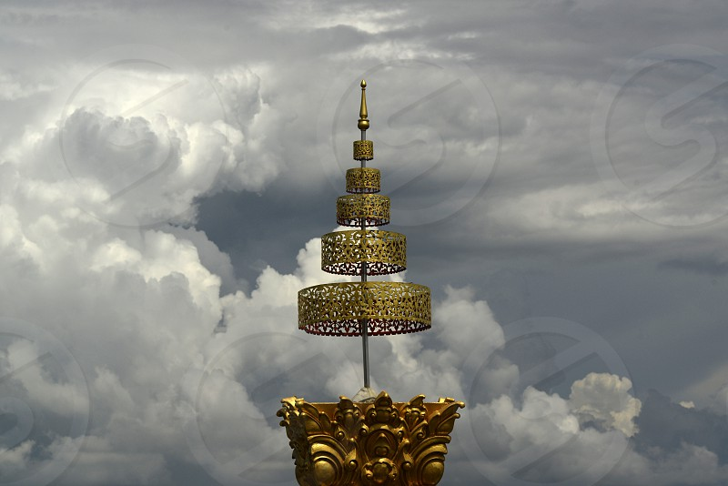 the large Temple or Chedi Phra Maha Chedi Chai Mongkhon on a hill near Roi Et in the  Provinz Roi Et northwest of Ubon Ratchathani in the Region of Isan in Northeast Thailand in Thailand. photo