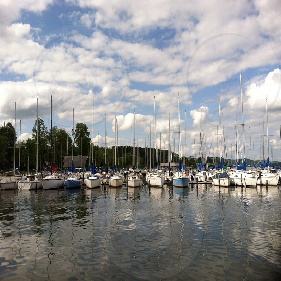 yachts lined on the water  photo