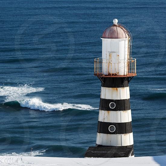 Lighthouse on coast of Pacific Ocean. Russia Far East Kamchatka Peninsula Petropavlovsk-Kamchatsky. photo
