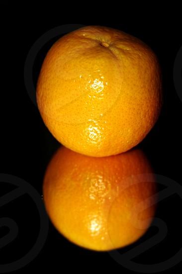 Orange fruit reflection photo