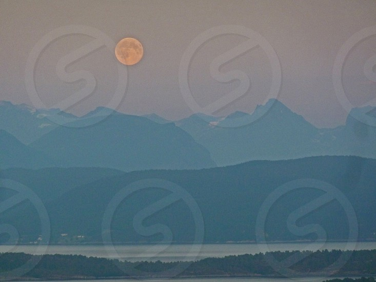full moon over the mountain and sea photo