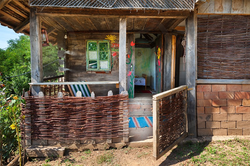 Old wooden house exterior. Part of a traditional household from Serbia during summer.  photo