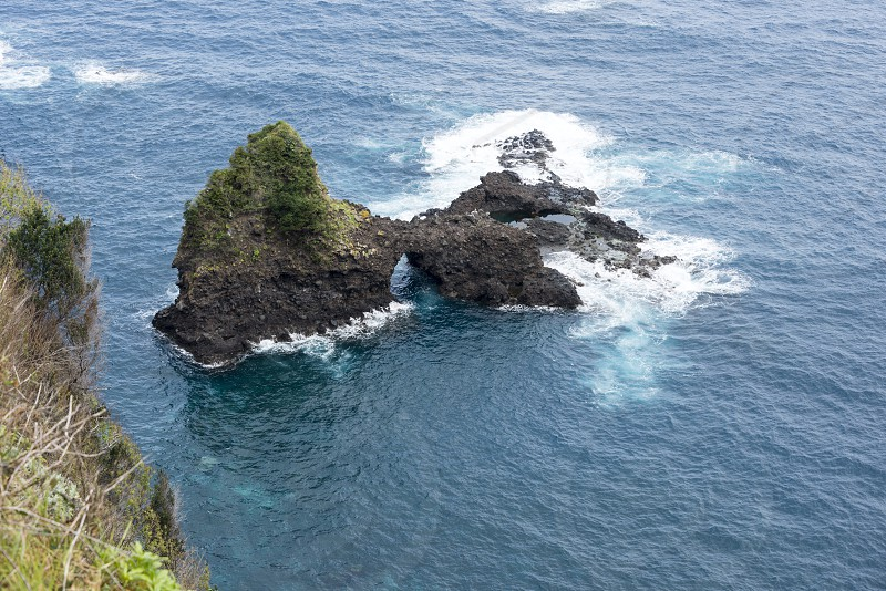 Famous rock in the atlantic ocean near Seixal om the portuguese island Madeira photo