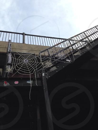 view of black staircase with spider webs photo