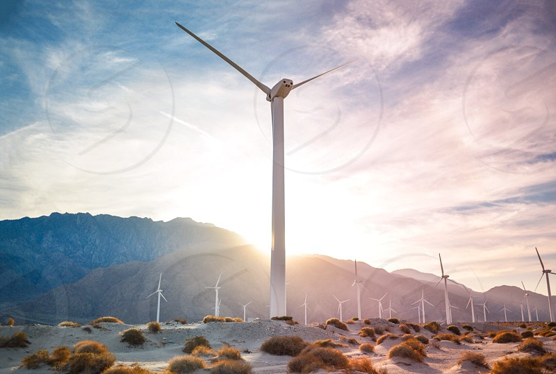 white wind turbines on sunrise photo photo