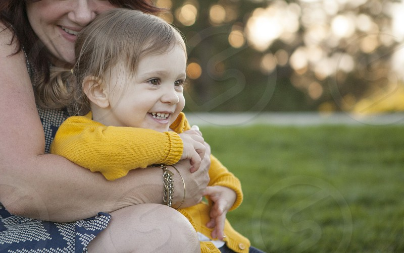mom hugging daughter happy smile toddler girl mother photo