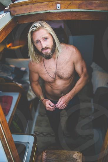 Man on a boat Blonde bearded man photo