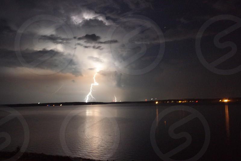 lightning striking on land during nighttime photo