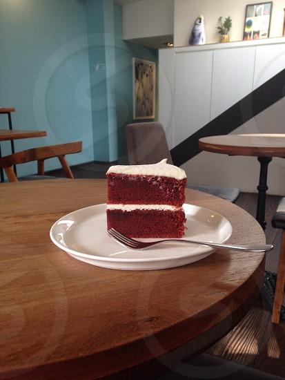 Red velvet cake in a robin's egg blue cafe interior photo