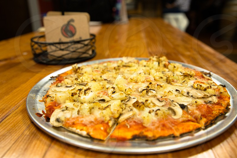 cheese pizza with mushroom on stainless steel ceramic tray photo