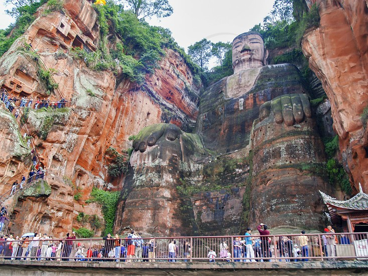 The Leshan Giant Buddha the largest and tallest stone Buddha statue in the world carved out of a cliff face that lies at the confluence of the Min River and Dadu River in the southern part of Sichuan province in China near the city of Leshan photo