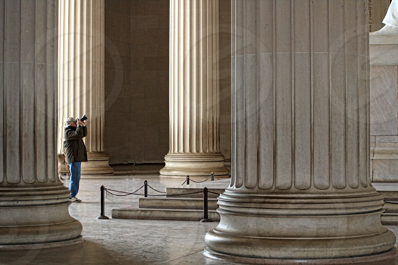 Photographer at the foot of the Abraham Lincoln statue in the Lincoln Memorial photo