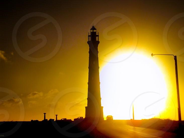 Chasing light sunset lighthouse photo