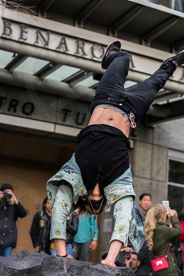 Dancer doing a handstand photo