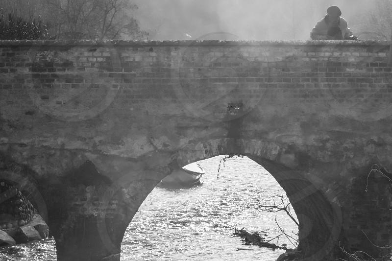 old man on the bridge watch the stream photo