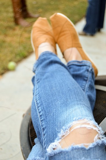 woman in blue denim tattered jeans and brown espadrilles photo