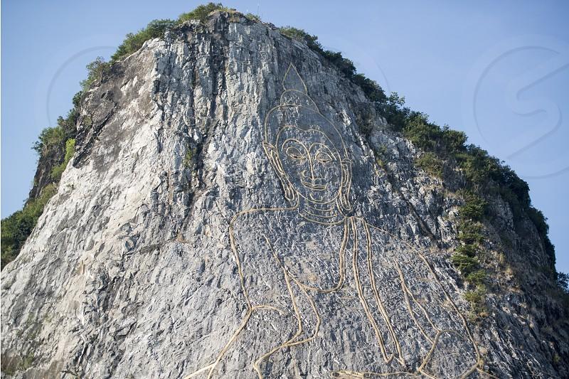 the Buddha Cliff of Khao Chee Chan at the village of Sattahip near the city of Pattaya in the Provinz Chonburi in Thailand.  Thailand Pattaya November 2018 photo
