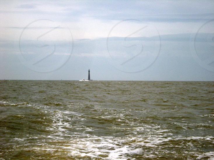 Lighthouse on the ocean photo