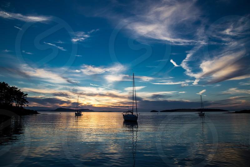 Calm sunset in quiet anchorage of Sucia Island. photo