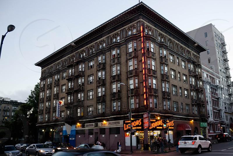 Hotel Tenderloin San Francisco neon lights liquors store neighborhood. photo