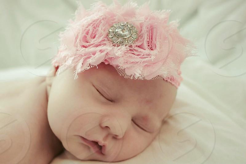 Sleeping newborn pink headband photo