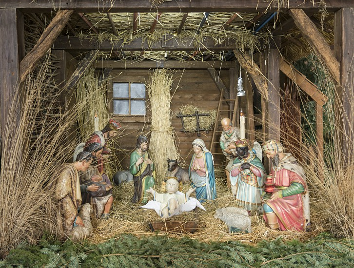 nativity decoration with christmas time  in church photo