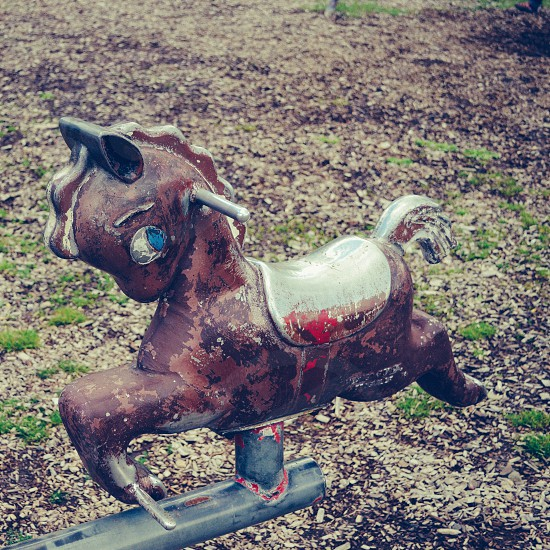 Vintage playground seesaw horse photo