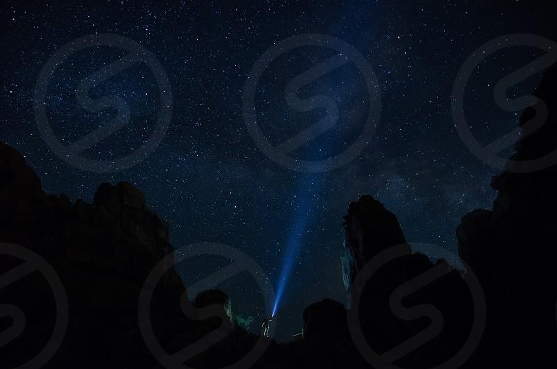 Joshua Tree National Park stars night scape man flashlight  photo