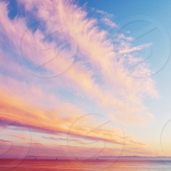 blue sky with white and yellow clouds photo